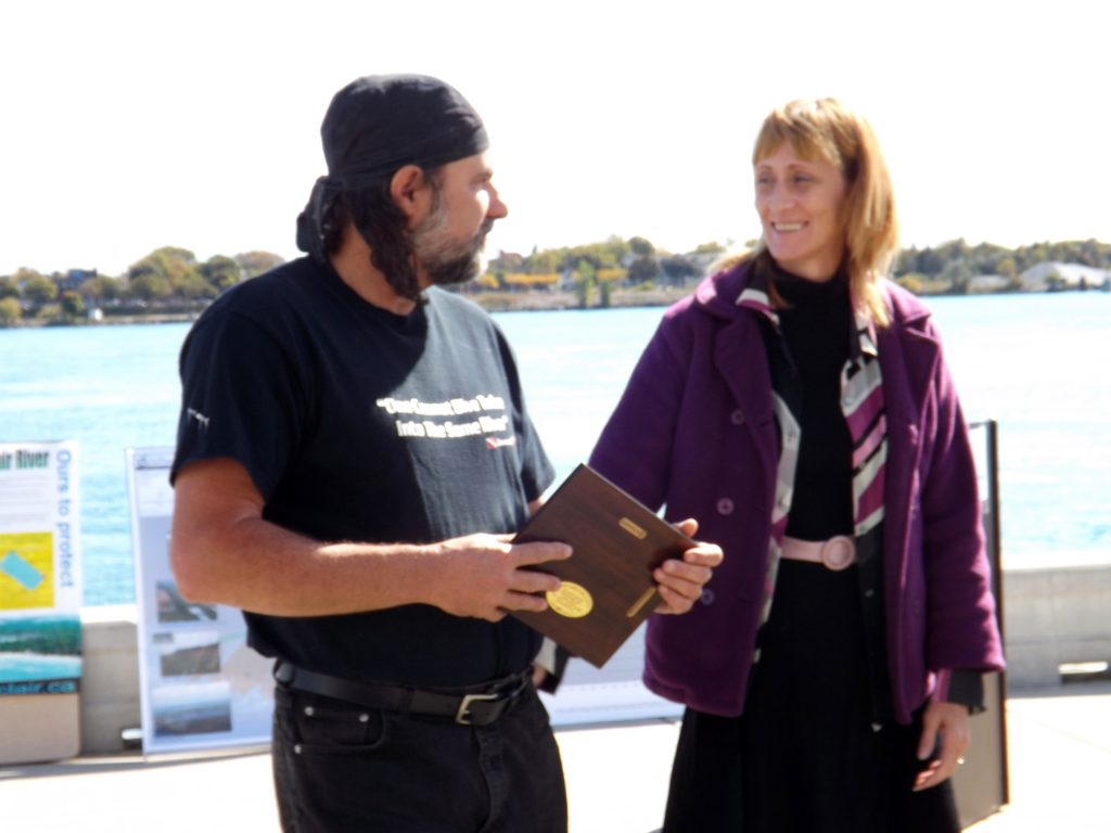 Greg Lashbrook and Kathy Johnson accept an award for their work on behalf of Great Lakes fish