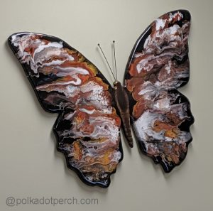 Artwork by Gregory Lashbrook butterfly shape painted with swirls of brown and white