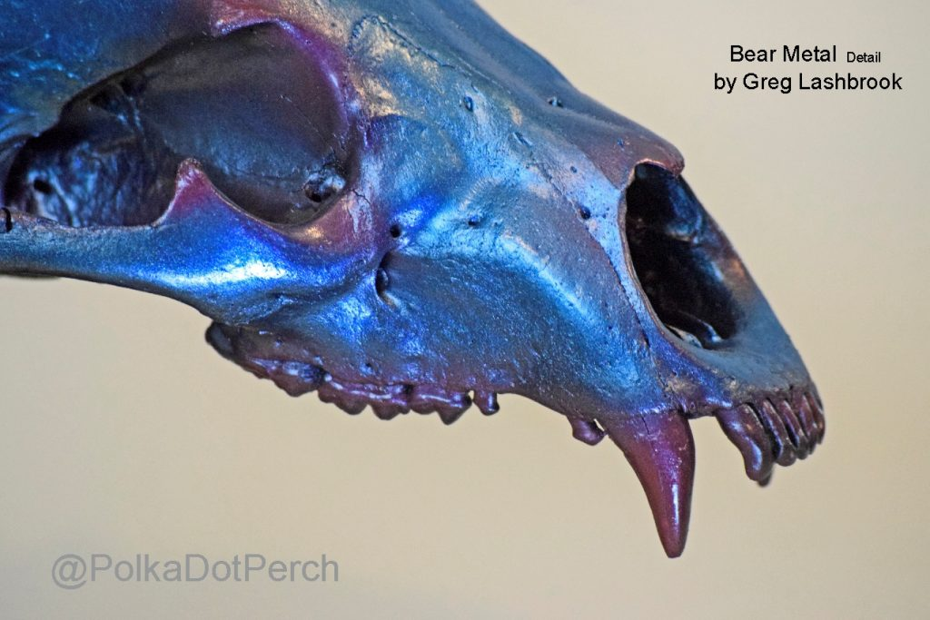 Bear Metal sculpture by Gregory Lashbrook close-up of bear skull painted a shiny blue