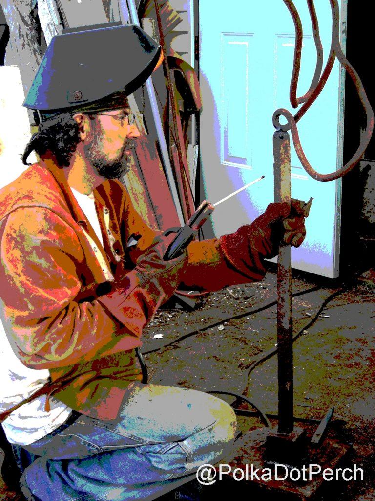 Artist Gregory Lashbrook welds a sculpture