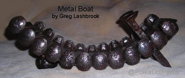 The Metal Boat sculpture by Gregory Lashbrook has an arch of welded railroad spikes with two at right angles